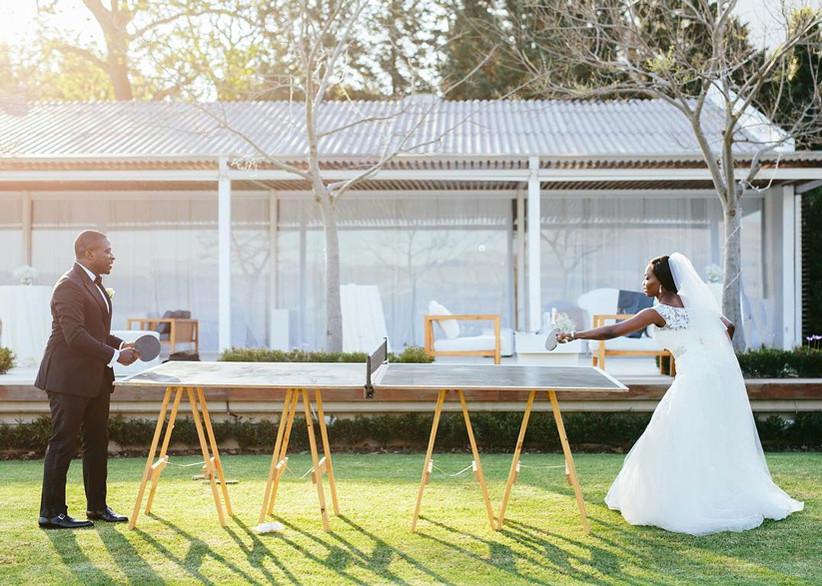 Brida and groom playing ping pong