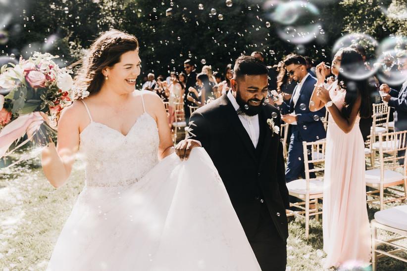 Outdoor wedding ceremony exit buubles