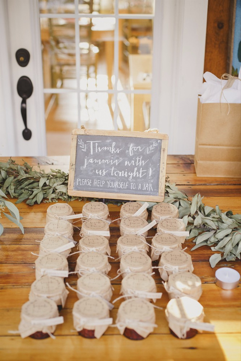 Rustic wedding favour display with chalkboard sign