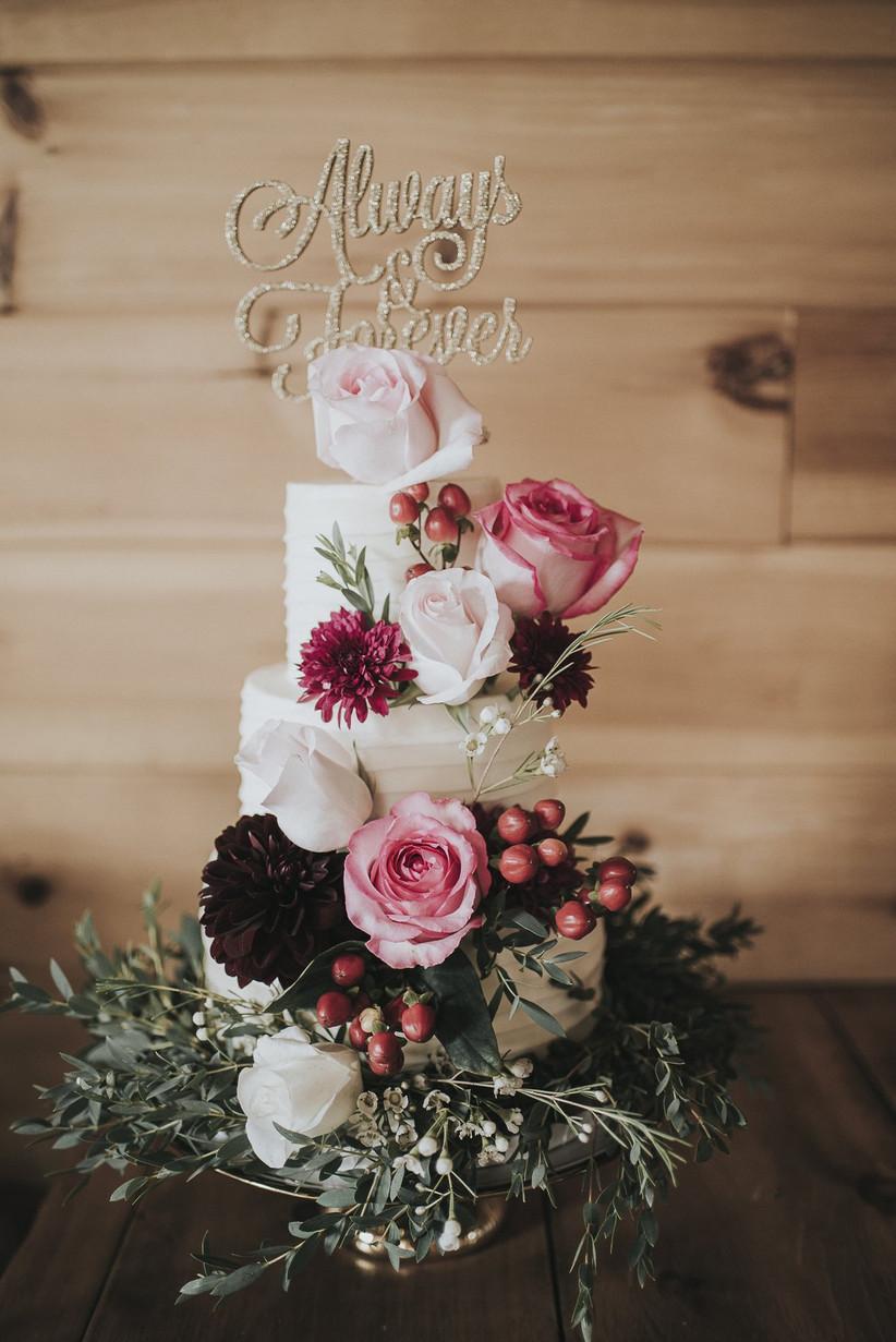 Rustic wedding cake with fresh flowers