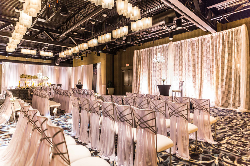 Wedding ceremony chairs decorated with fabric