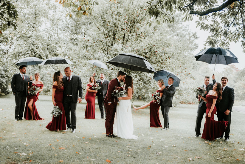 Wedding party photo in the rain