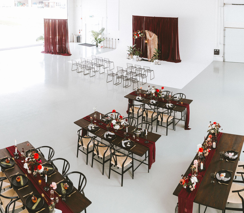 Micro wedding in large aircraft hanger