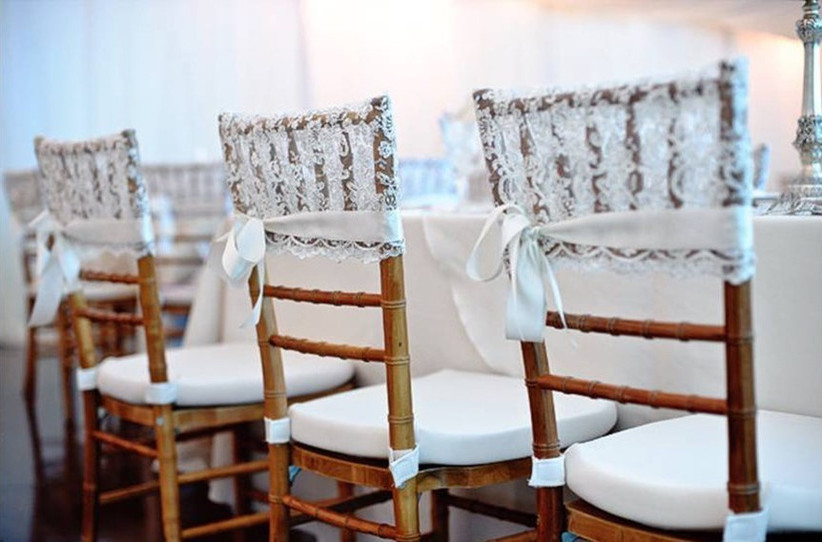 Wedding chairs decorated with lace