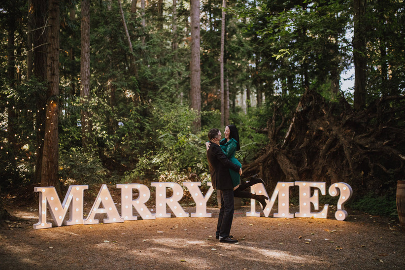 Marry Me sign in the woods