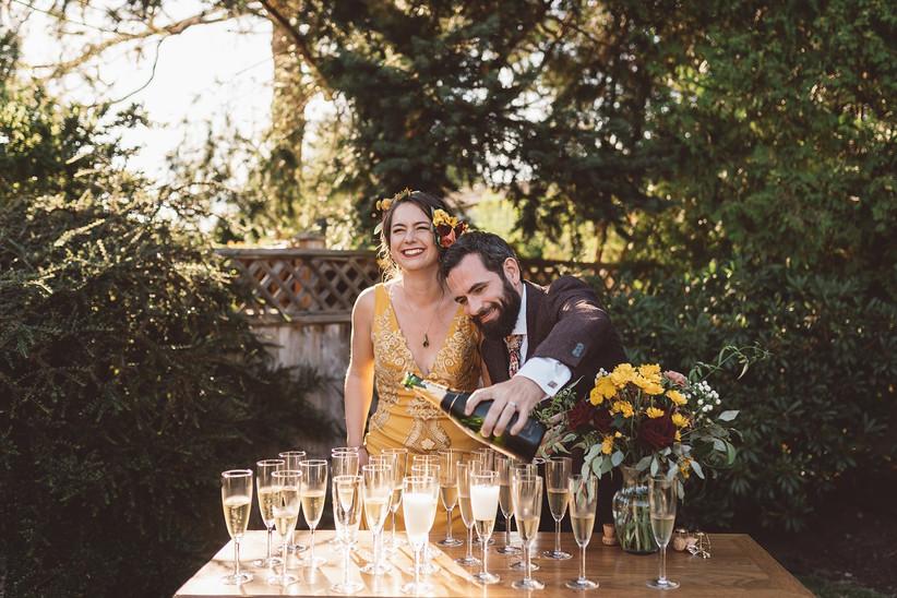 Backyard wedding champagne toast