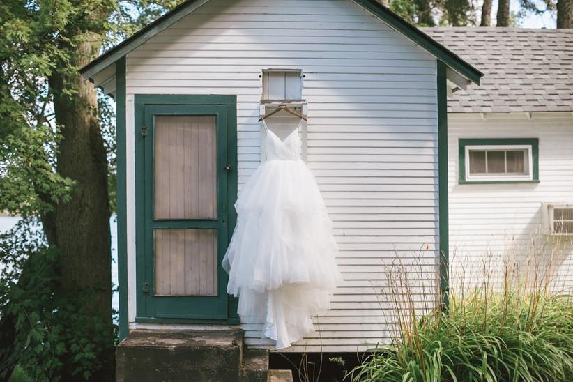 Wedding dress hanging on a cabin