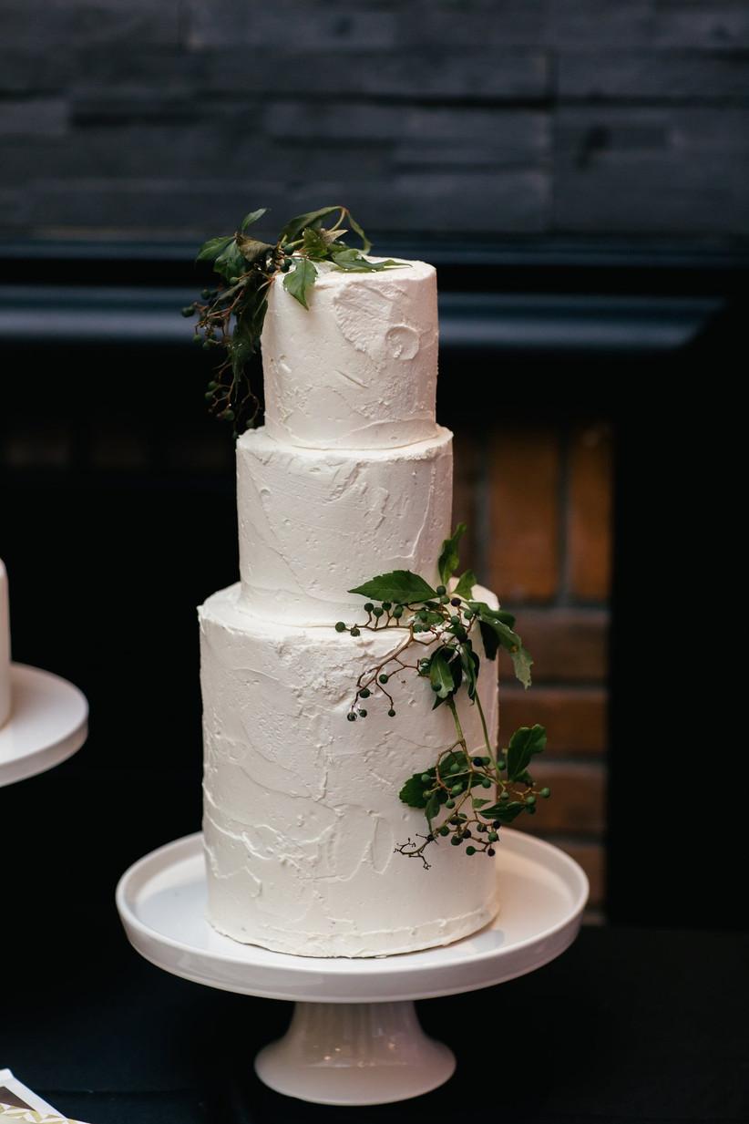 Rustic wedding cake with greenery