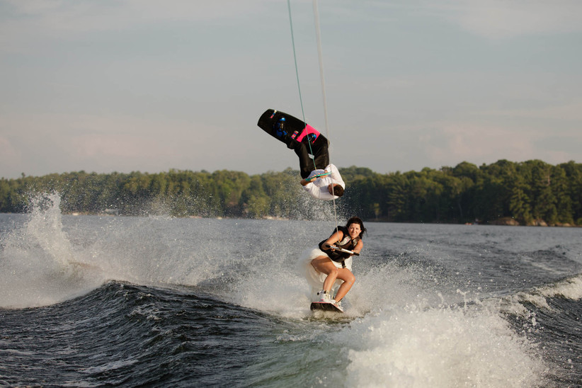 Bride and groom on waterboards