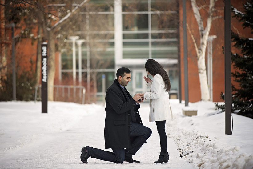 Marriage proposal down on one knee in the snow