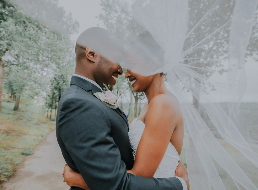 Wedding portrait with bridal veil blowing in the wind