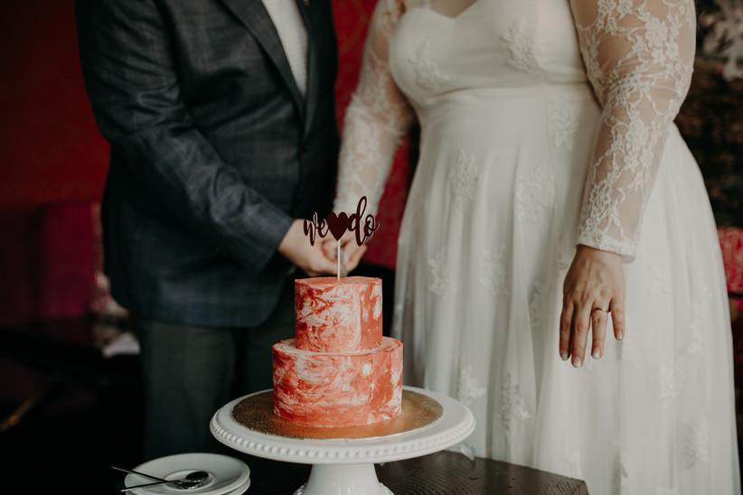 Small red swirl wedding cake