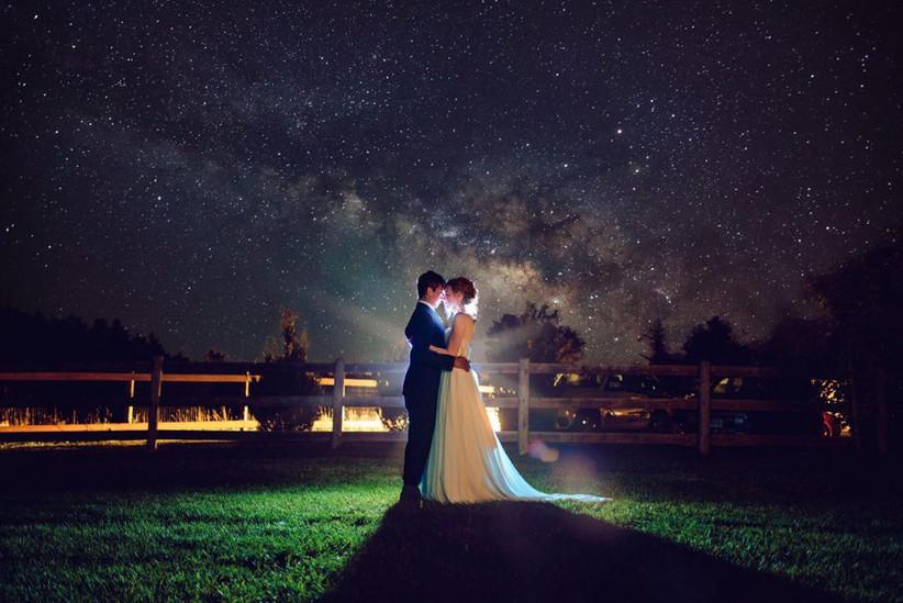 Backyard wedding portrait at night
