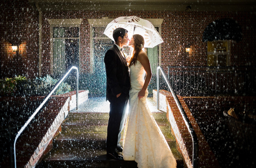 Wedding portrait in the rain