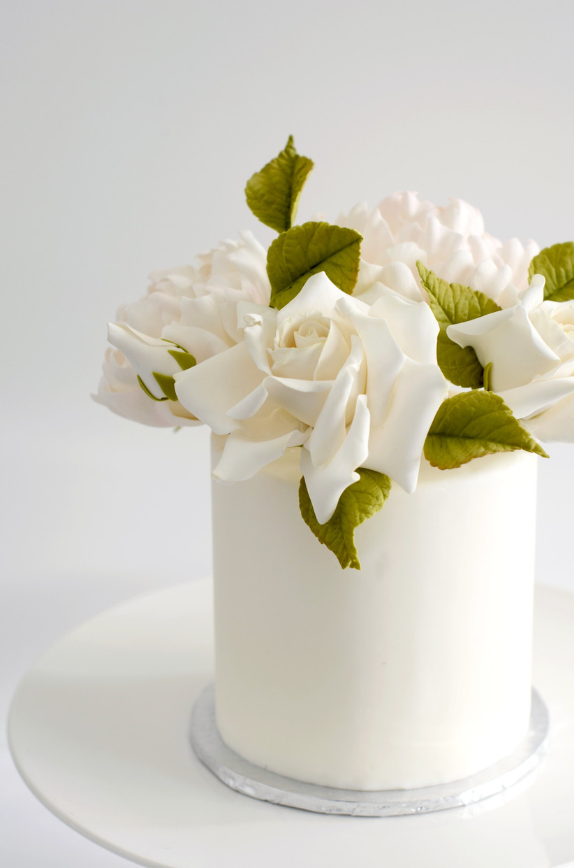 Small wedding cake with large sugar flowers