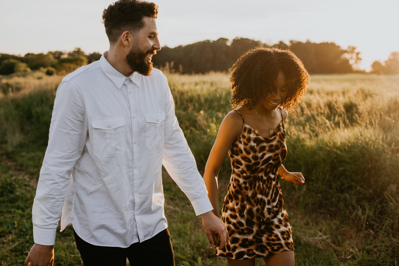 Engaged couple walking in the countryside