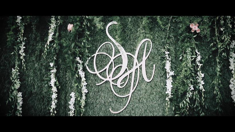 Wedding monogram backdrop with greenery