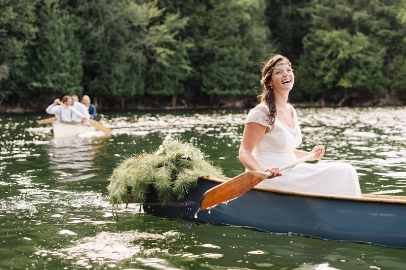 Bride arriving in a canoe