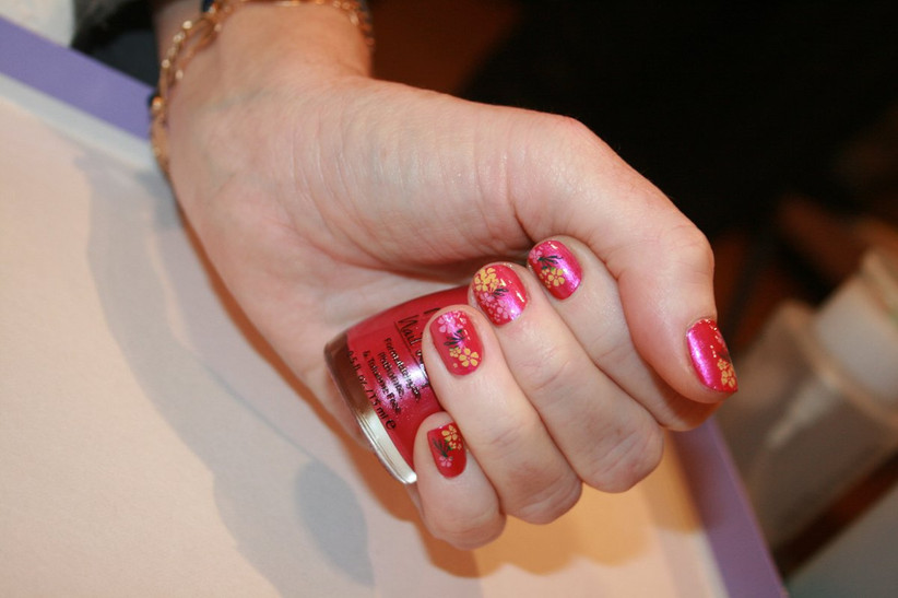 Red nail polish with design