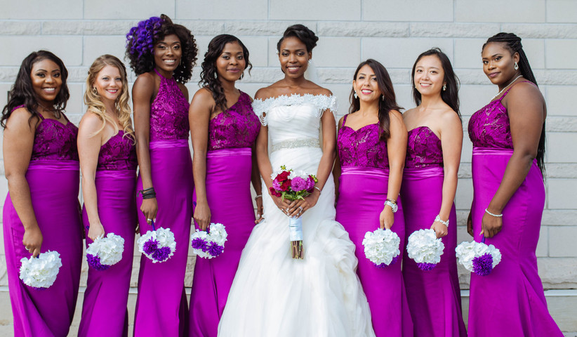 Bride with bridesmaids wearing fuchsia pink dresses