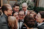Bridal party group hug