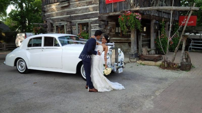 Couple by the rolls royce