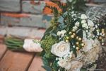 Bridal bouquet by brick wall
