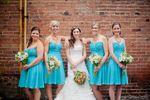 Bridesmaids by brick wall