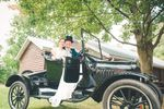 Bride & Groom on old car