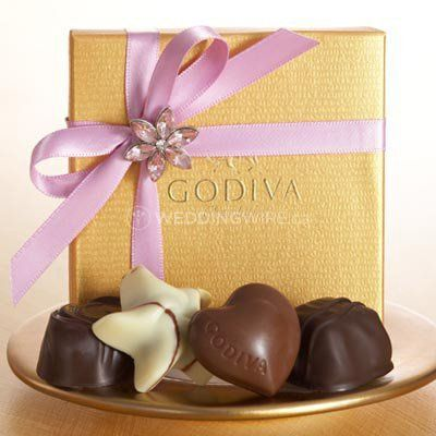 Gold favor with lilac ribbon and flower