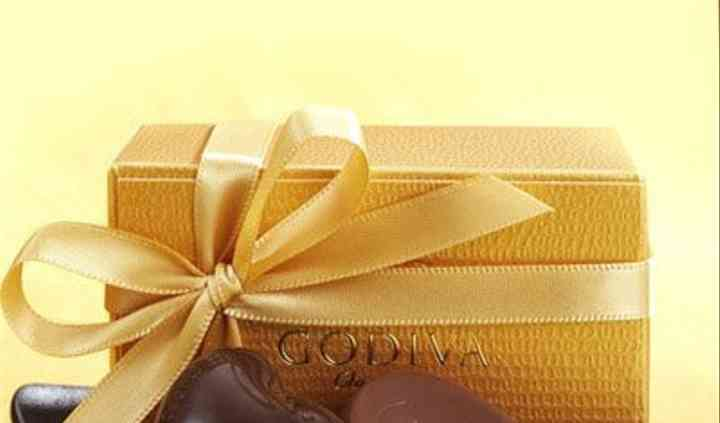 Gold favor with gold ribbon