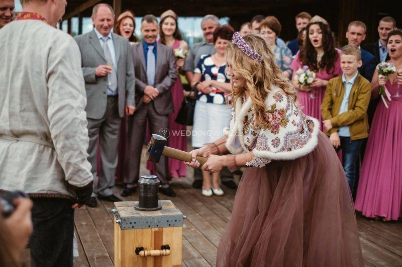Bride striking a wedding coin