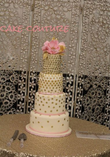 Four tier cake with edible flo