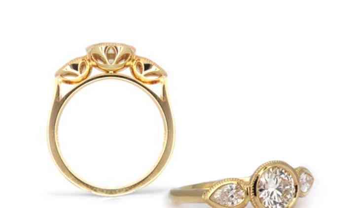 3 Stone Diamond 18ky ring.