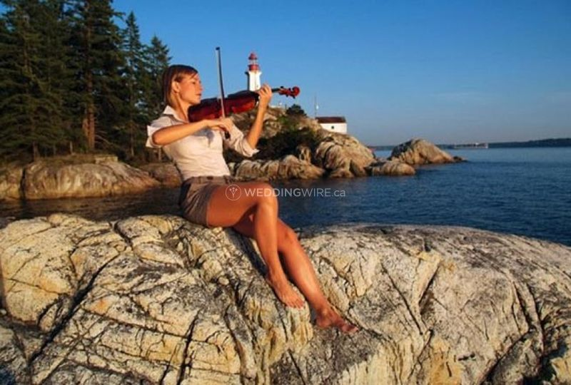 Outdoor lighthouse violinist