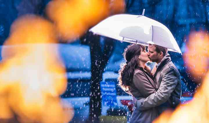 Engagement in pouring rain