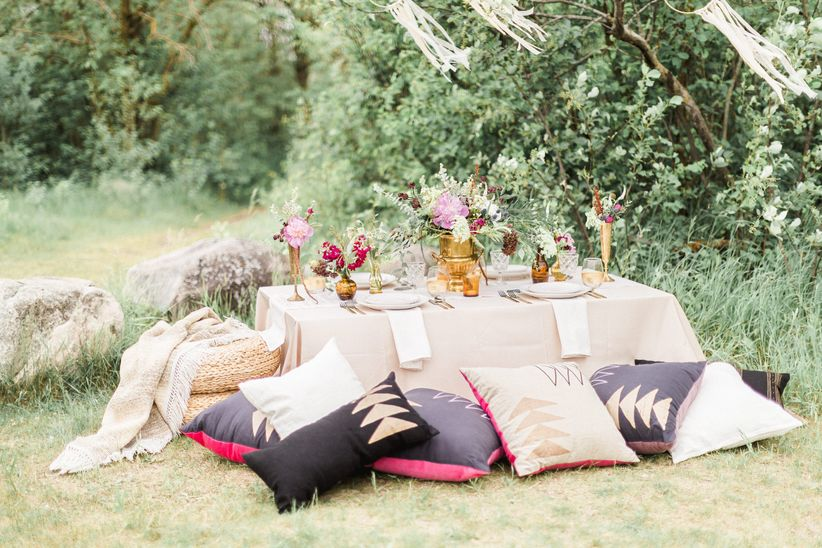 Rustic wedding decor idea - Pouf and pillow seating