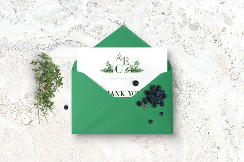 Green wedding invitation with monogram