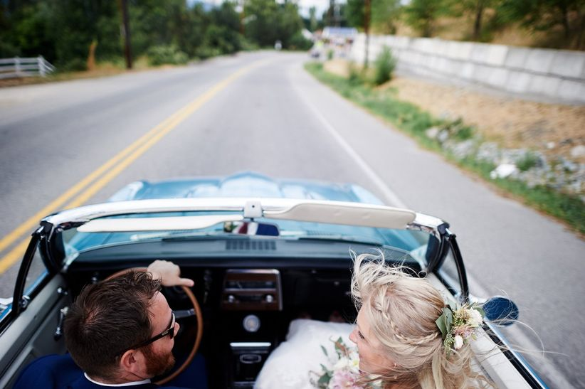 Newlyweds in a convertible car