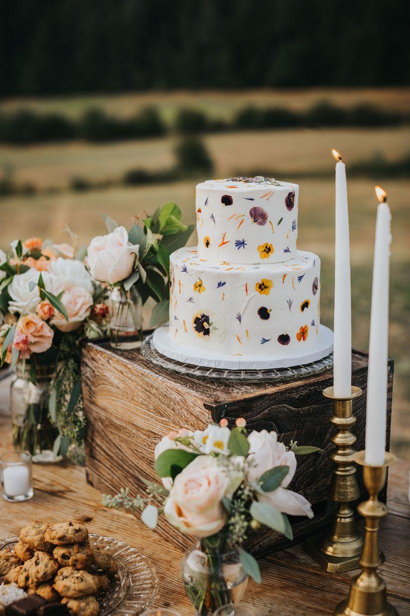 Pressed wildflowers rustic wedding cake
