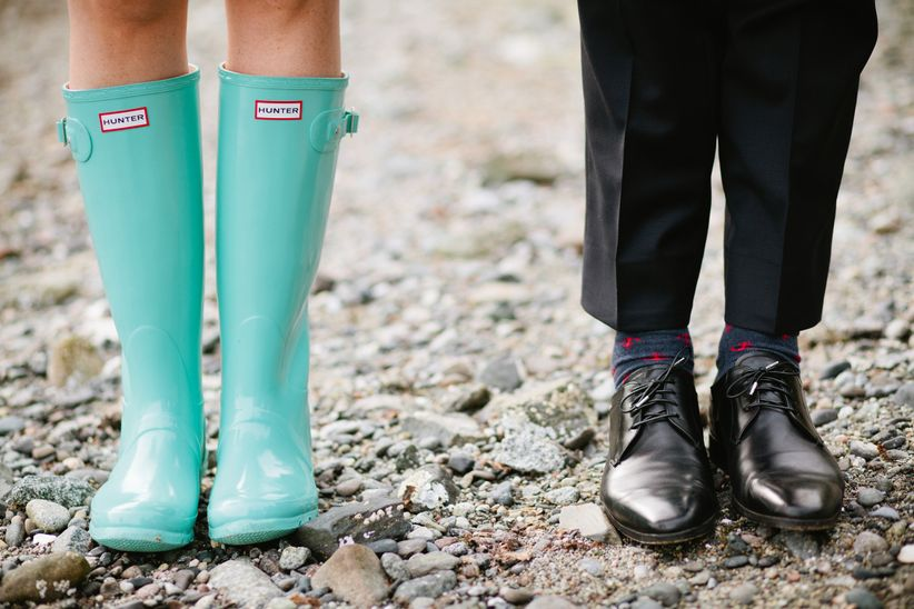 Bride wearing Hunter boots at Painted Boat Resort