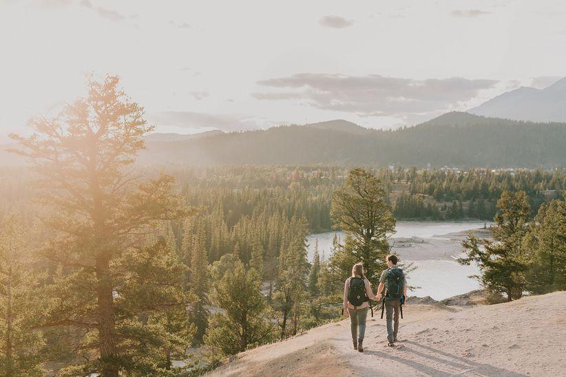 Engagement photo of couple hiking