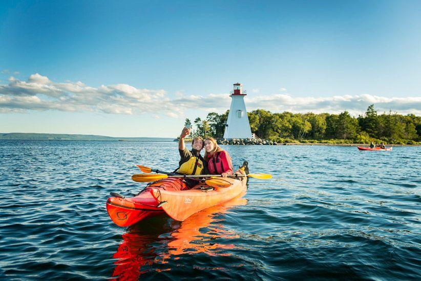 Newlywed couple in kayaks