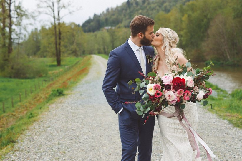Wedding portrait with large spring bouquet
