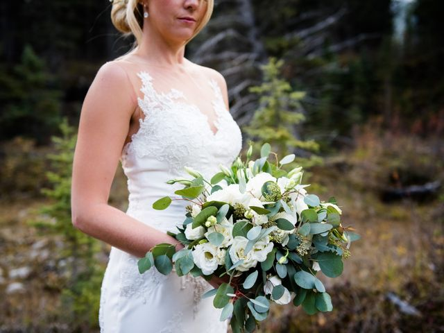 Riley Frame and Kimberly White's wedding in Canmore, Alberta 32