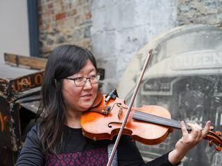 Auspicious Melody - Violinist 1