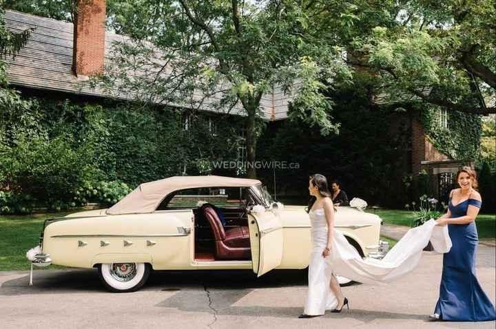Bride Getting Into Vintage Car