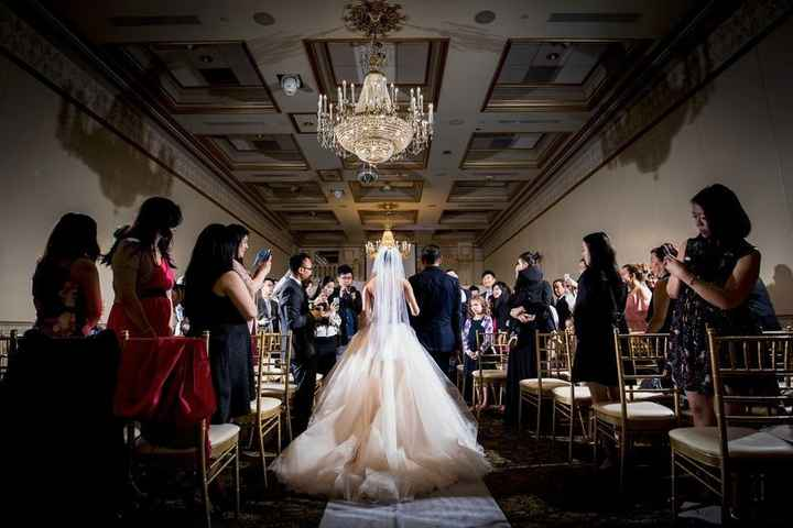 Bride Walking Down The Aisle In Big Tulle Ballgown