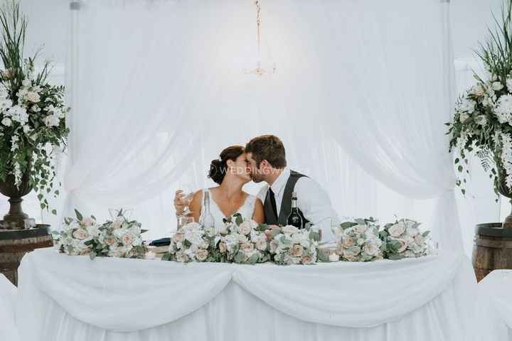 Reception Kiss at White Sweetheart Table