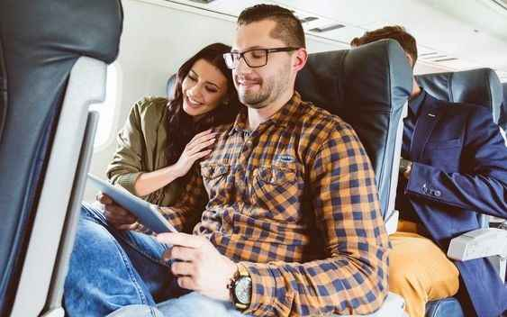 couple sitting on a plane together